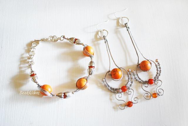 Immagine-ott2010-001 Orecchini e bracciale argento e pietre arancio