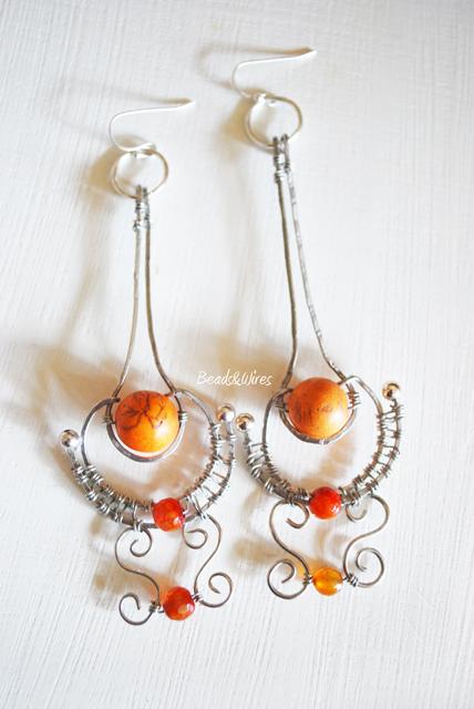 Immagine-ott2010-007 Orecchini e bracciale argento e pietre arancio