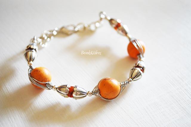 Immagine-ott2010-013-1 Orecchini e bracciale argento e pietre arancio